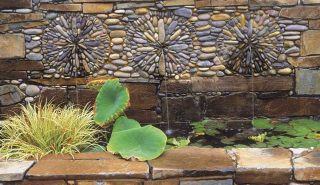 Wall cladding outside the house with sea pebbles