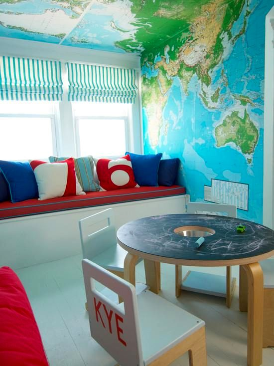 geographic maps on the wall and ceiling in the nursery