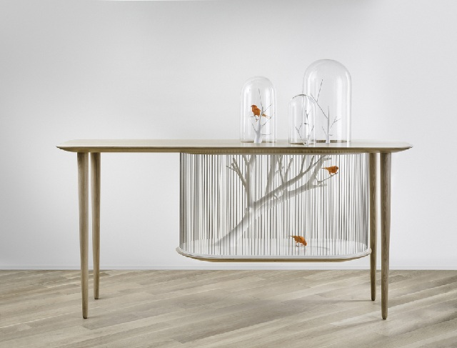 Decorative cage for birds, built into the table