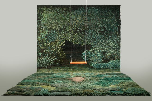 grass mat and tapestry on the wall