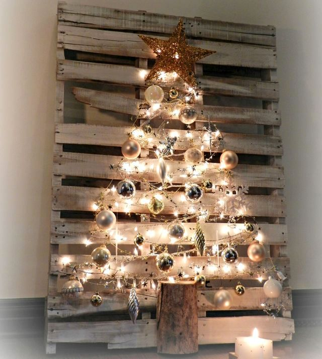 Christmas tree from a pallet with balls and garlands