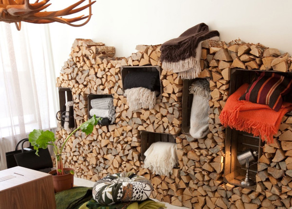 Firewood in the room as decor and shelves