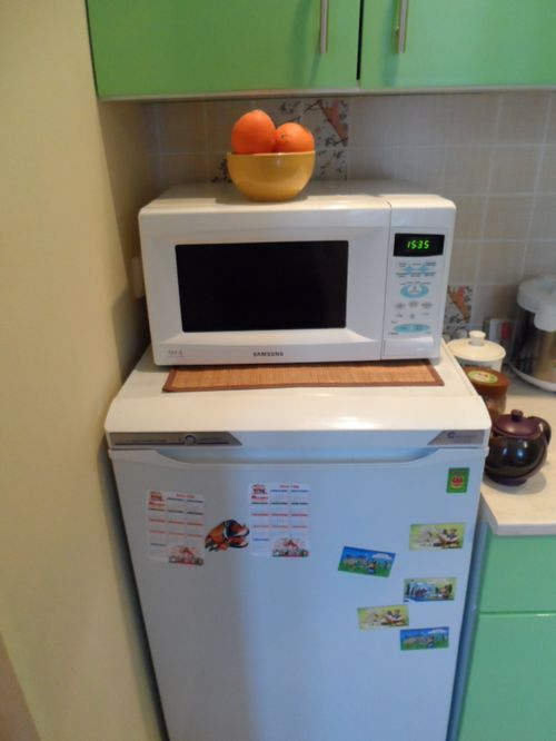 Microwave oven on the refrigerator