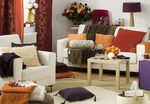 Decoration of the living room by autumn with textiles