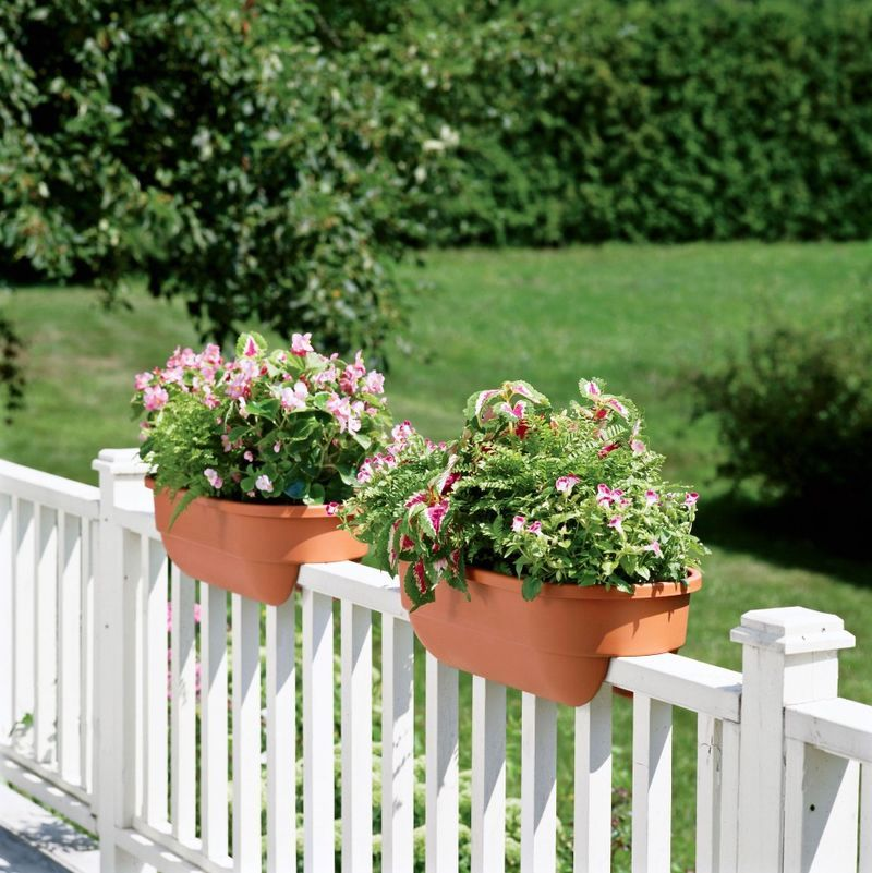 pots on railing and fencing