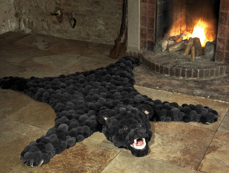 carpet of pompoms in the form of bear skin