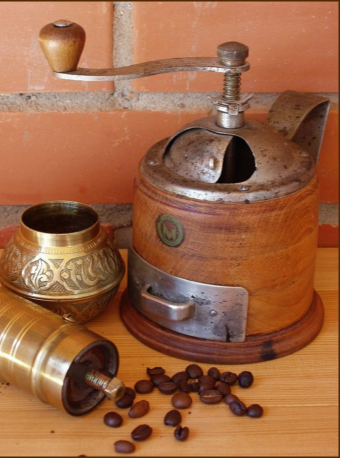 Forged coffee grinder and kitchen items - practical decoration for the interior