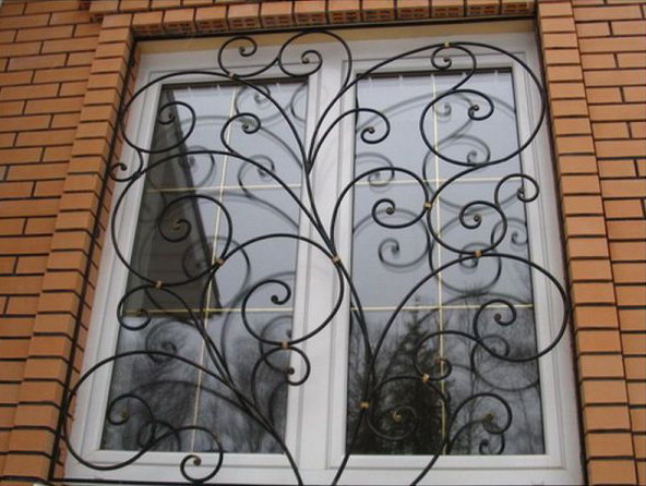 Forged window grille - safe and beautiful
