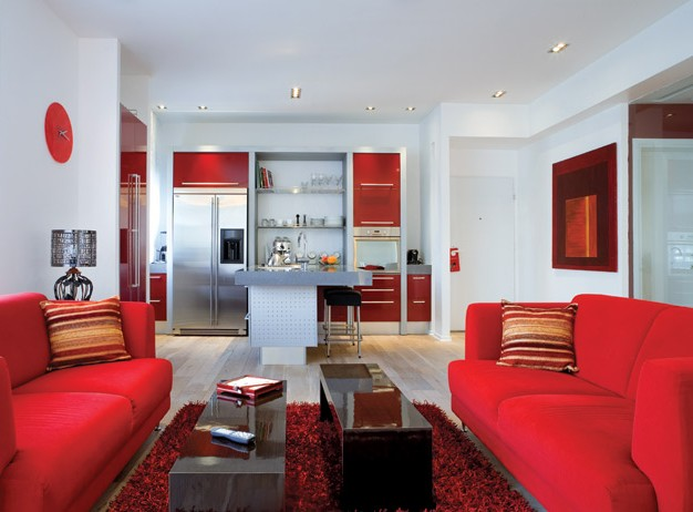 Two red sofas in the living room