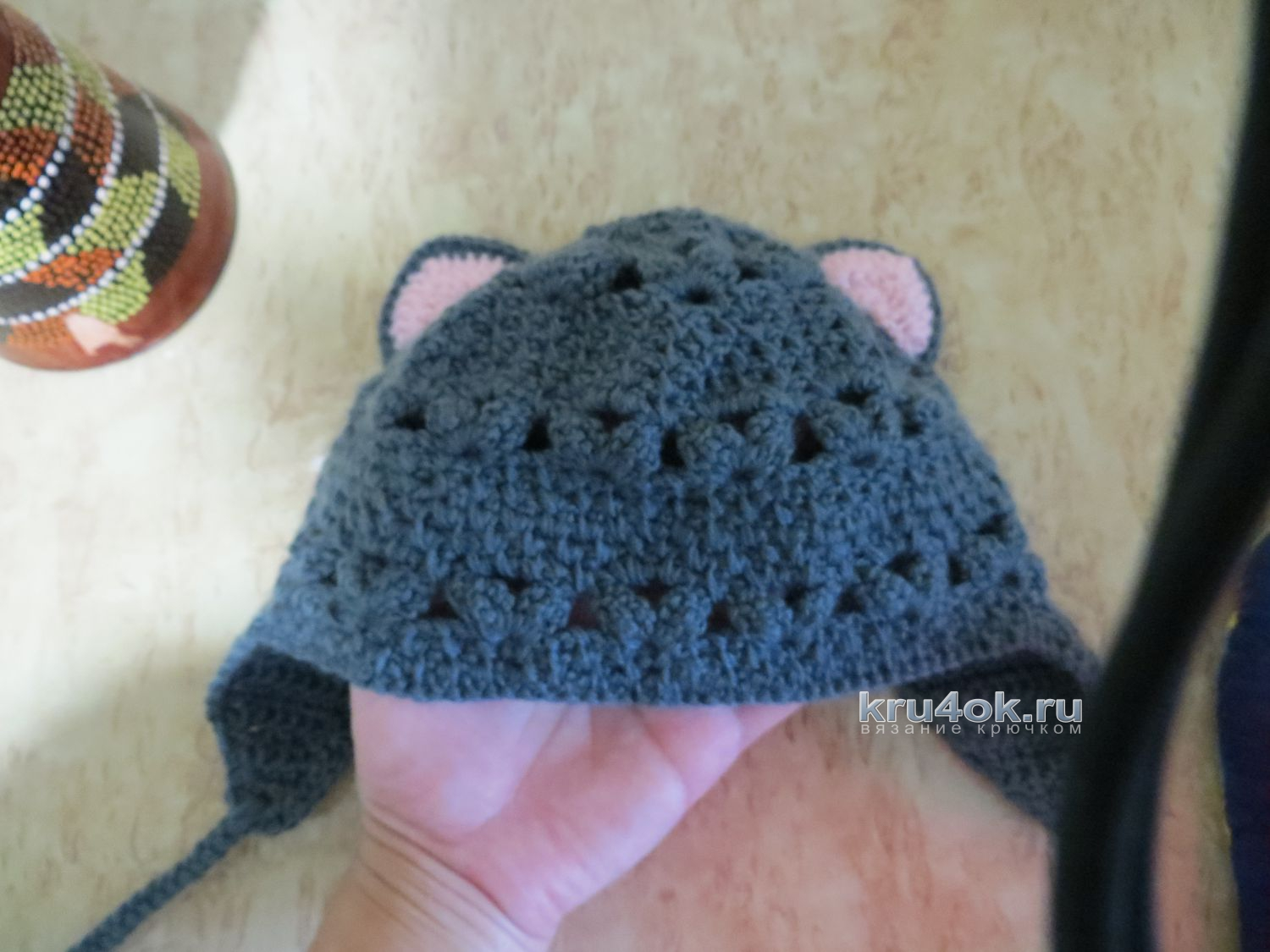 Cap for the girl crocheted. The work of Roxanne
