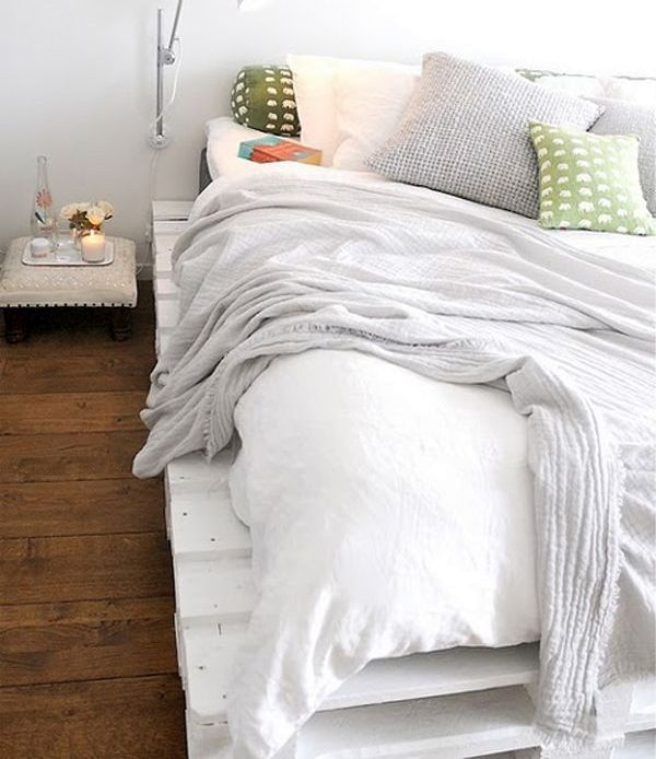 white bed with own hands from pallets