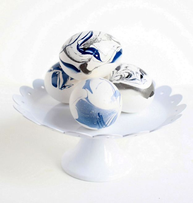 blue-white marble Easter eggs with own hands