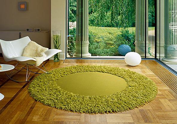 Fluffy green round carpet - the lawn in your home