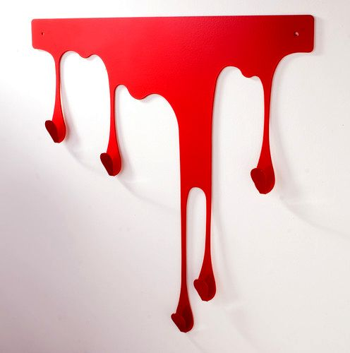Wall hanger in the form of a stain of blood