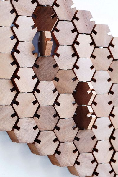 Wall hangers in the hallway in the form of honeycomb