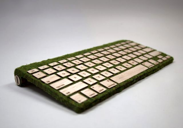 Wooden keyboard with grass