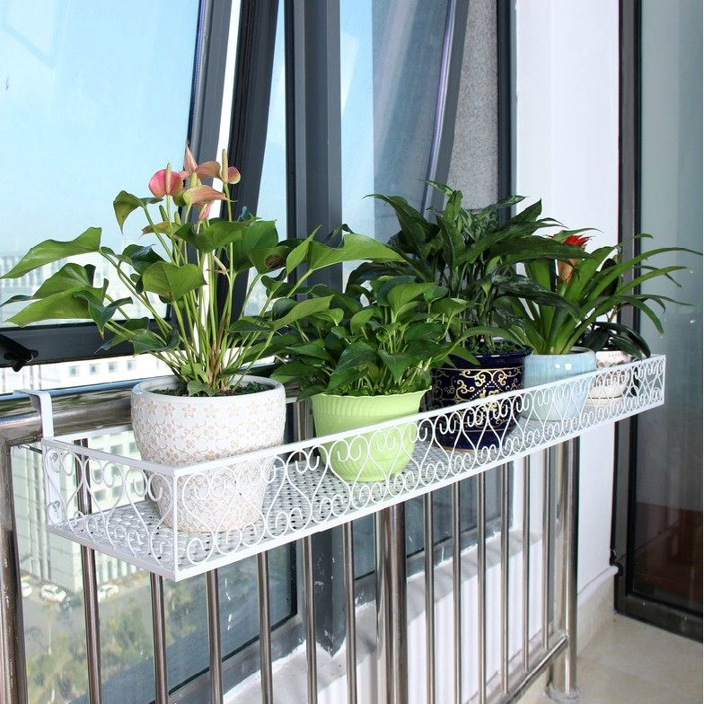 hanging forged shelf for flower pots on railing