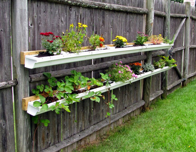 Hanging flower beds for a fence
