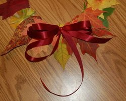 Autumn decoration. Wreath from autumn leaves by own hands