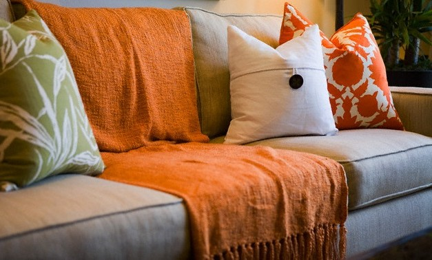 Pillows and fluffy rugs in the autumn decor of the living room