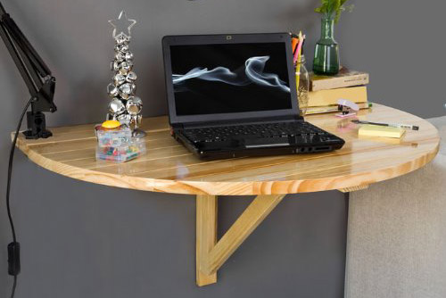 Folding table with fastening to the wall