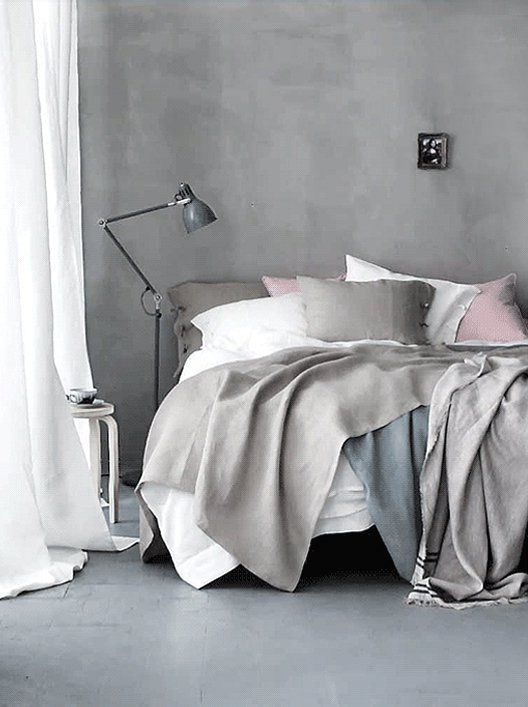 bedroom interior in pastel colors with a predominance of gray