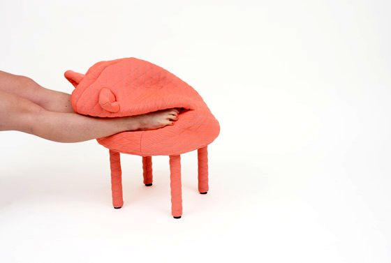 Stool for feet with a heater in the form of a pig