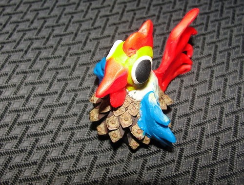 Craft of a cock from cones and plasticine