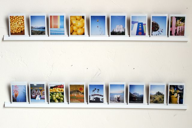 How to hang photos on a concrete wall