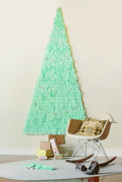 Flat paper Christmas tree on the wall