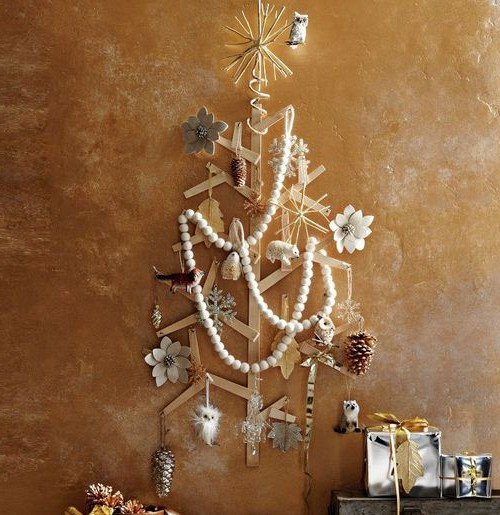 Flat wooden christmas tree on the wall