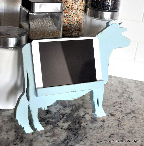 Stand for a tablet in the form of a cow