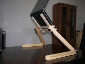 Stand for laptop from wood.