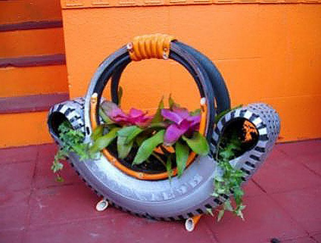 Original crafts from a car tire in the form of a basket for flowers