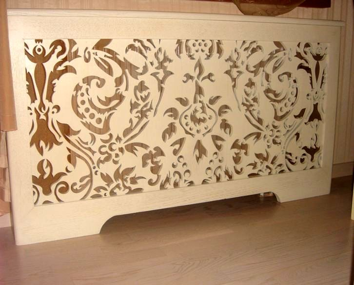 carved wooden screen on the radiator