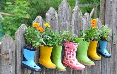 Hanging garden made of colorful rubber boots