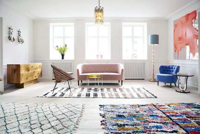 Bright interior of the living room in Scandinavian style with bright color accents