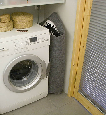 basket for laundry in the bathroom in the form of a shark