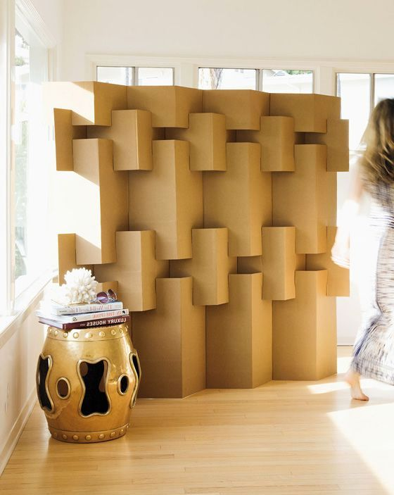 a screen of cardboard with their own hands - rectangles