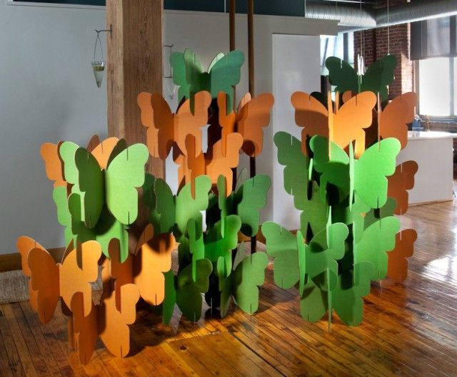 a screen made of cardboard in the form of butterflies