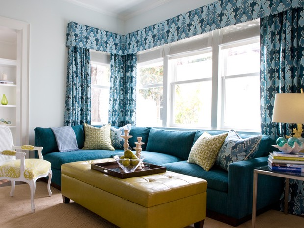 Turquoise sofa and yellow table in the living room
