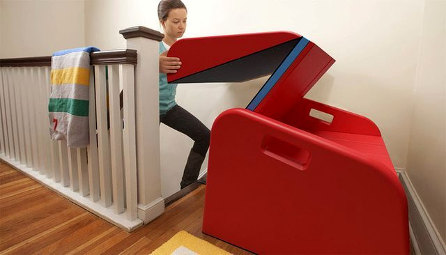 installation of a children's slide on the stairs in the house