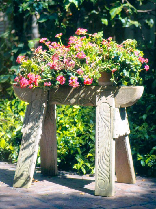 carpenters as a pedestal for flowers