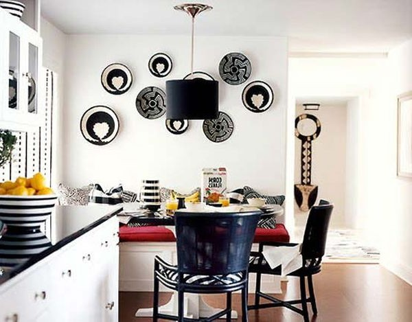 A composition of decorative plates on the wall