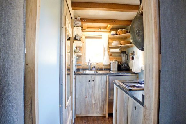 Kitchen in a small summer house on wheels