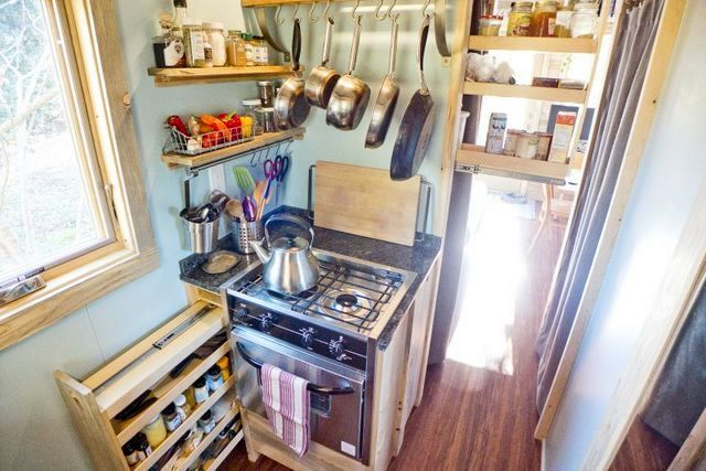 Kitchen in a small summer house on wheels made by own hands