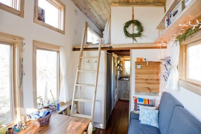 Stairs to the bedroom area from the living room of the house on wheels