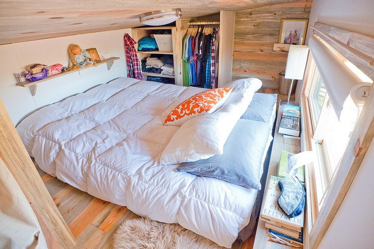 The bedroom itself with a large mattress instead of a bed and a locker for storing clothes