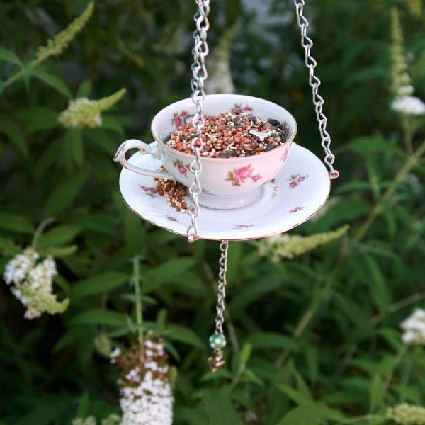 Suspended bird feeder from cup and saucer