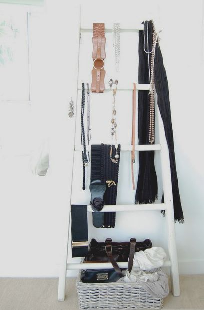 stepladder in the interior as a clothes hanger
